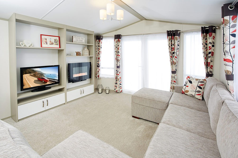 The living area with plenty of fixed seating & a stylish entertainment unit.